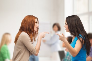 An image of two young women arguing