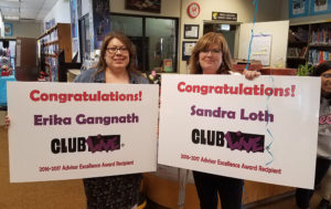 Friday Night Live advisors hold congratulatory signs