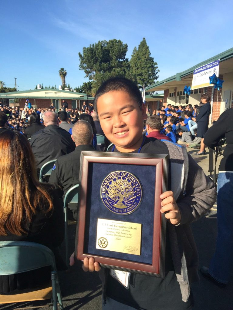 A student holds a plaque