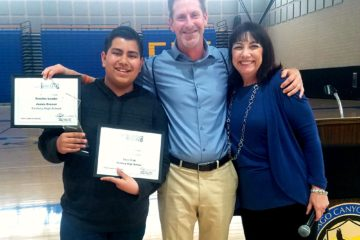 Project Tomorrow CEO Julie Evans presents Luis Diaz and Teacher Leader James Oveson with competition awards.