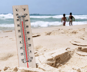 An image of a thermometer on the beach