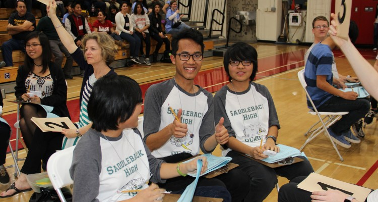 Students smiling at the Orange County Academic Decathlon