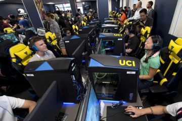dozens of students sit in front of computers participating in online gaming at UC Irvine