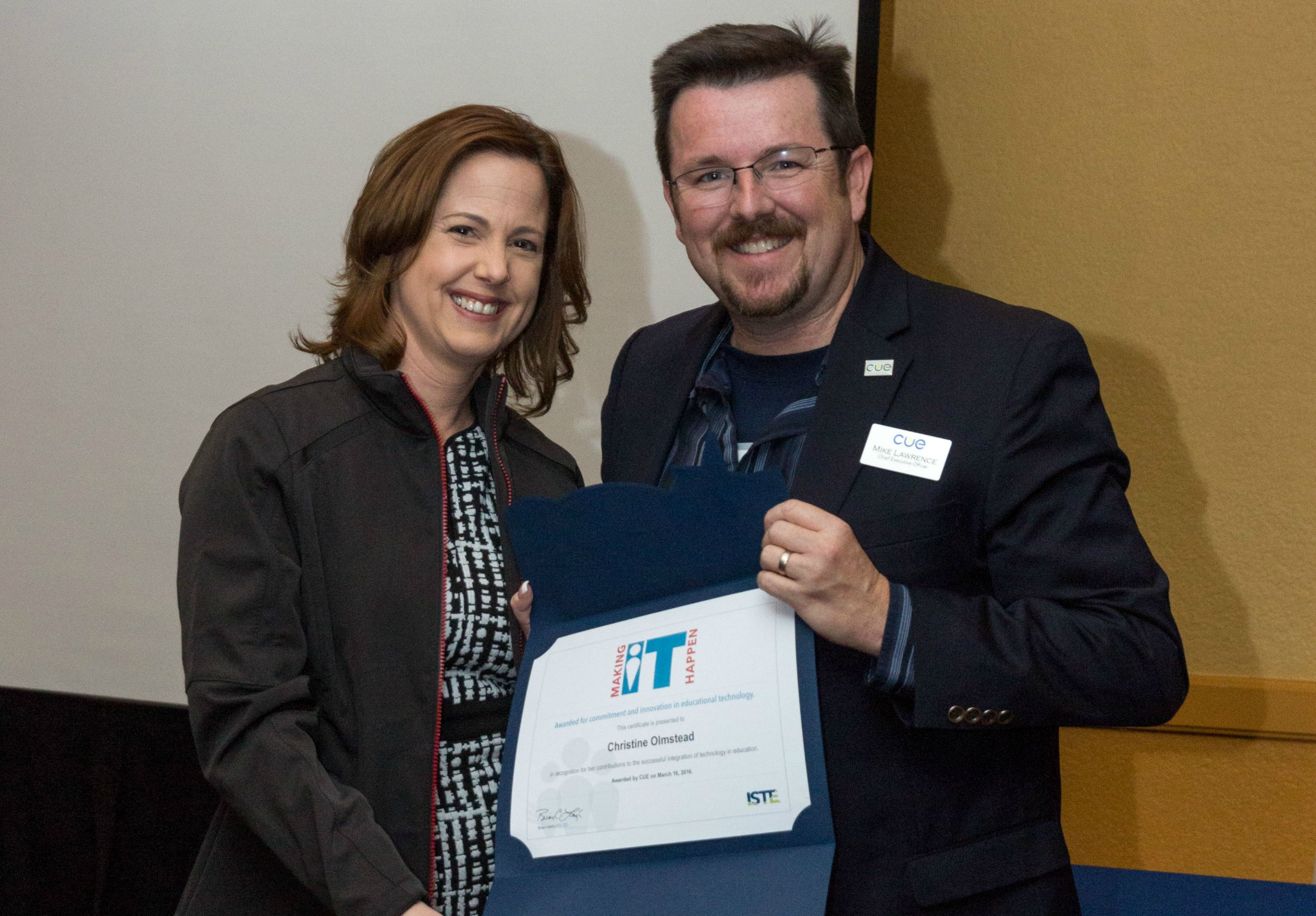 An image of OCDE Assistant Superintendent receiving the Making IT Happen award