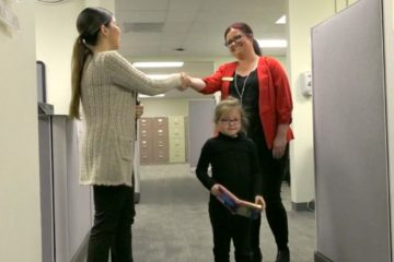 A mother and daughter are greeted at OCDE's Child Care Services program