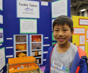 A Tustin student at Irvine Valley College's Astounding Inventions competition