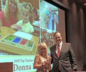 """Donna Dowicki is presented with Parenting OC magazine's """"Top Teacher"""" award by SchoolsFirst Federal Credit Union President and CEO Bill Cheney."""