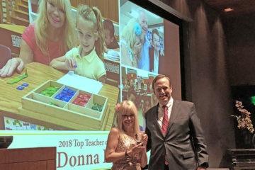 "Donna Dowicki is presented with Parenting OC magazine's ""Top Teacher"" award by SchoolsFirst Federal Credit Union President and CEO Bill Cheney."
