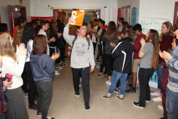 Students cheer a senior who applied for college