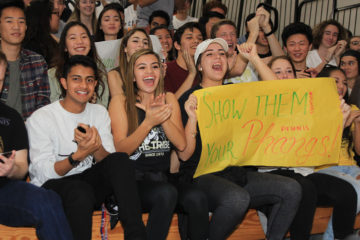 Audience members cheer at the Orange County Academic Decathlon
