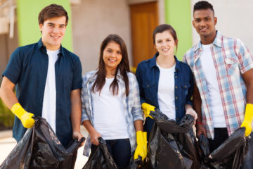 Teenage volunteers with garbage bags