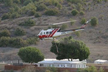 An image of an OC Fire Authority helicopter