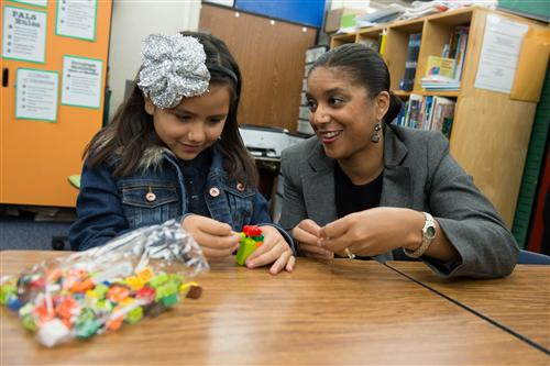An image Santa Ana Unified School District Superintendent Stefanie Phillips and a student