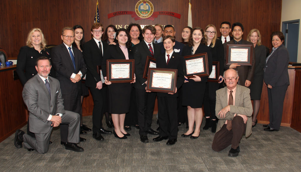 Pacific Coast High School's mock trial team at the board meeting