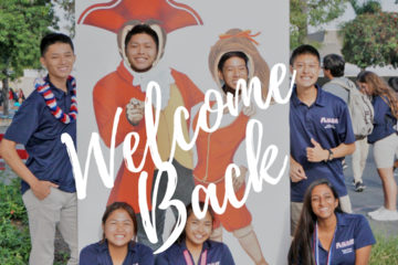 "Oxford Academy students pose with a ""welcome back to school"" sign"