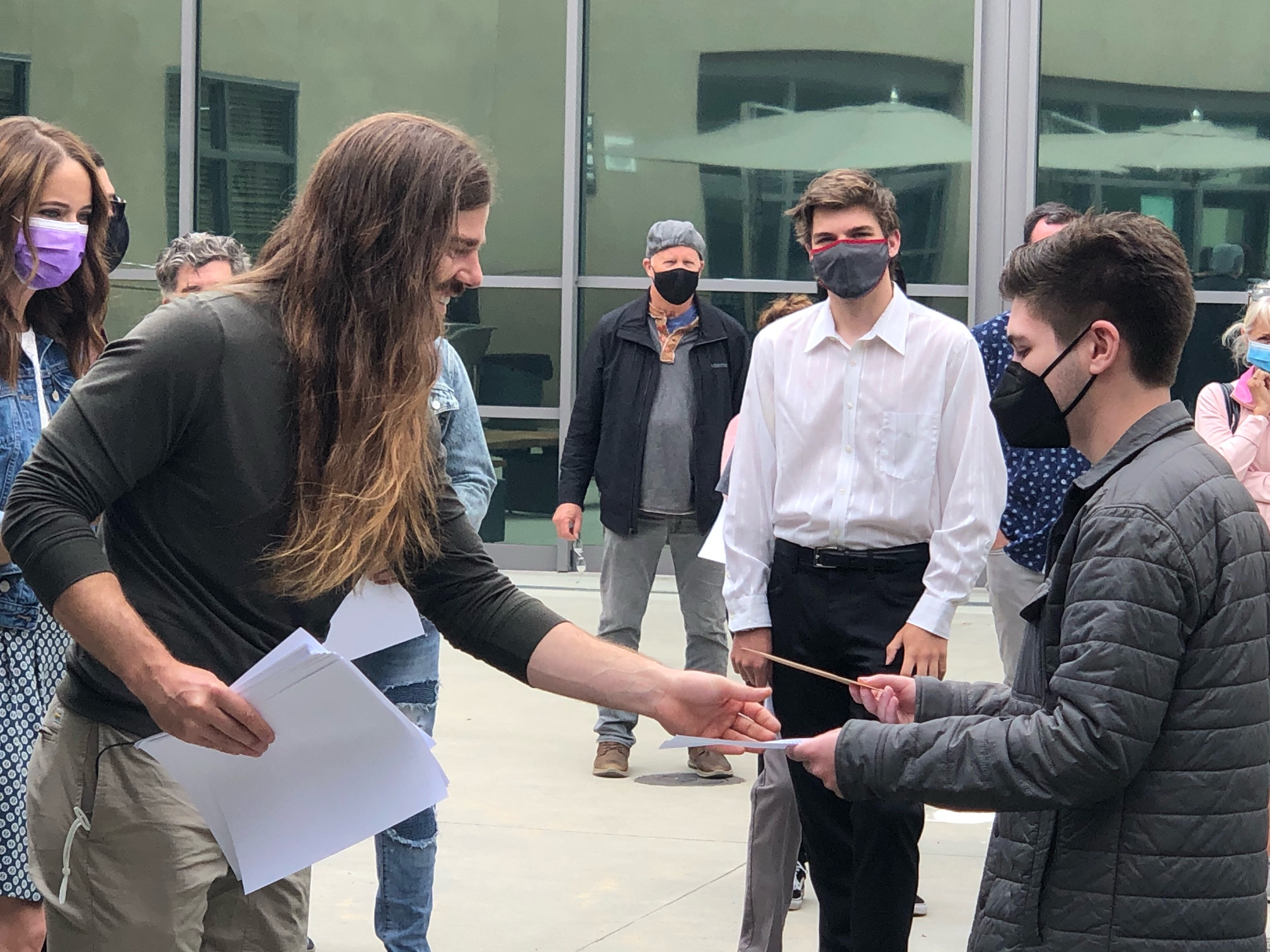 A six-year promise between Irvine students and a Seattle-based CEO turns into nearly $50,000 in college scholarships